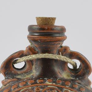 Ampullae de sigilata decorada con una guirnalda vegetal